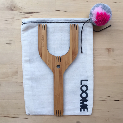 loome-slingshot-xl-model-in-pom-pom-bag
